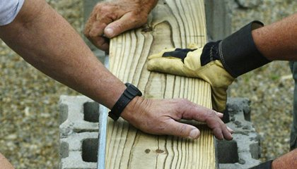 Builders hands on wood